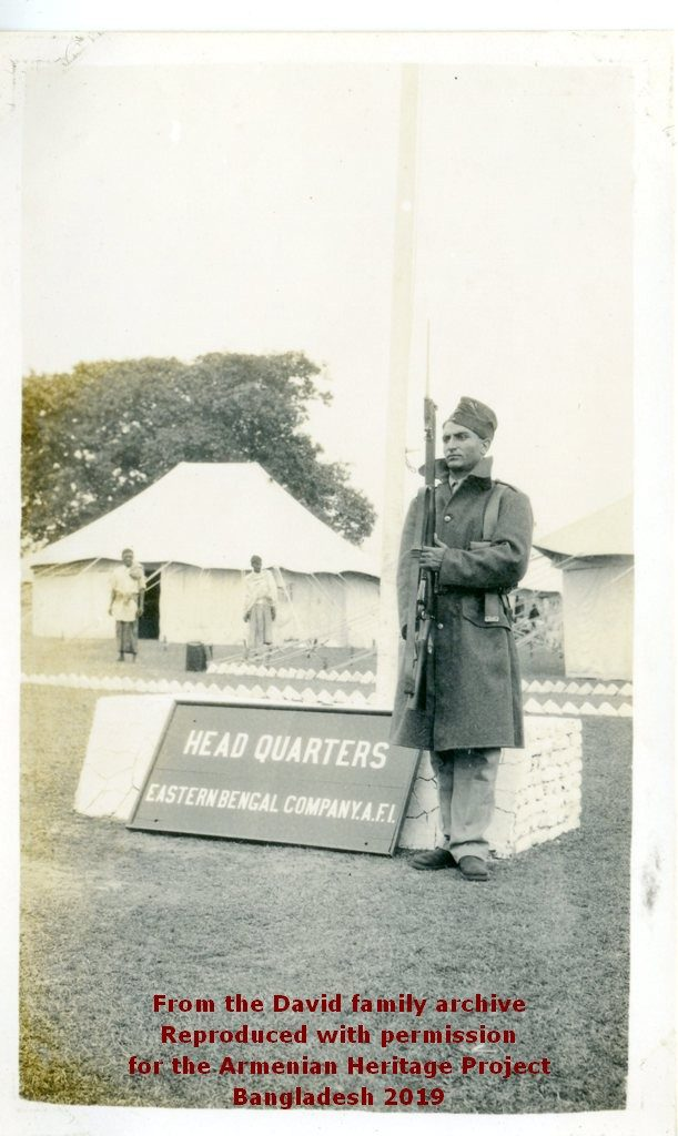 Eastern Bengal Coy Headquarters tent. Ruben David posing with his rifle.
