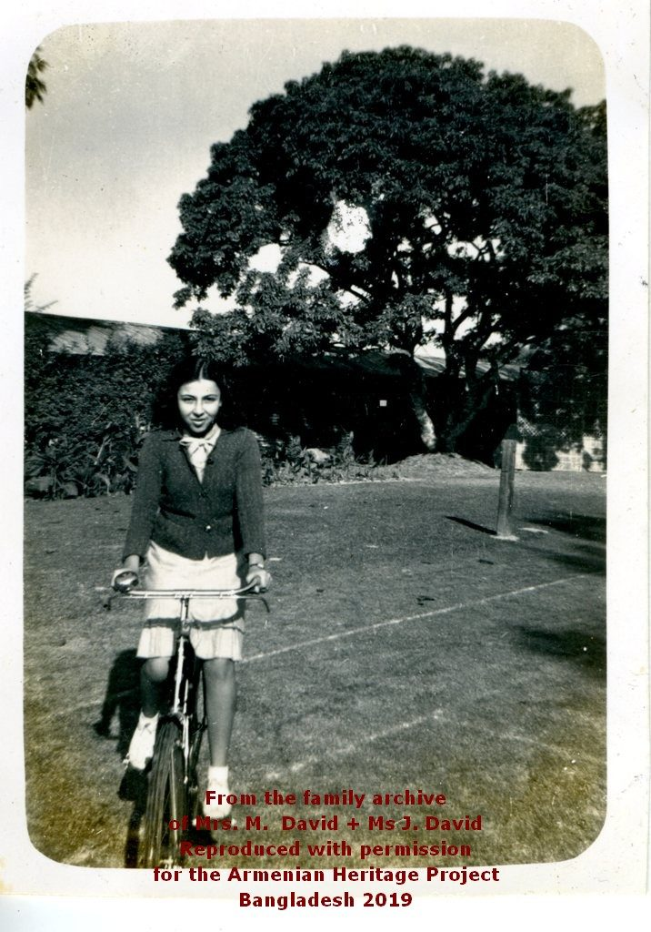 Nellie David on her bike in grounds of church