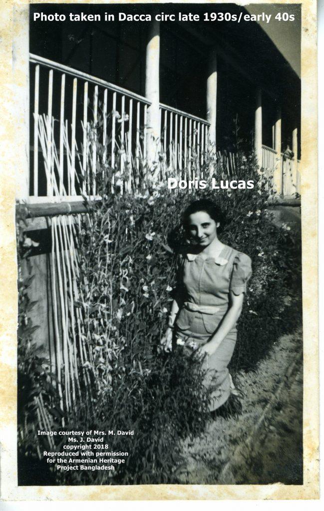 Doris Lucas by some flowers
