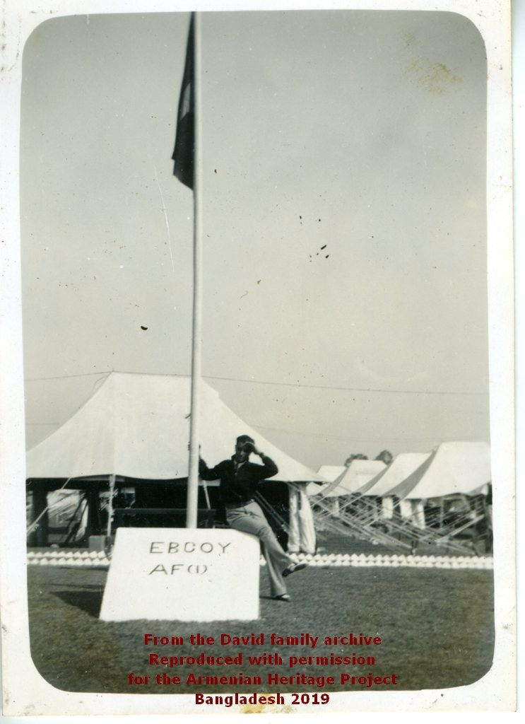 Ruben David by the Eastern Bengal Company sign and flag